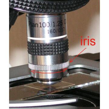 Planobjektív (100x) iriszblendével sötéttérvizsgálathoz Aplan100x-iris